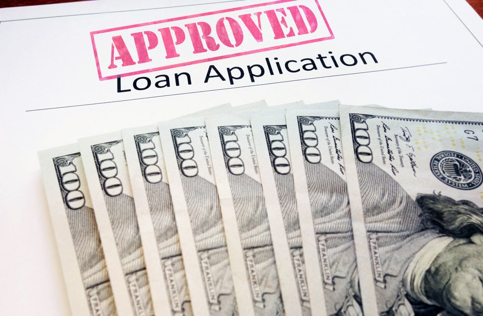 Approved auto title loan application and cash