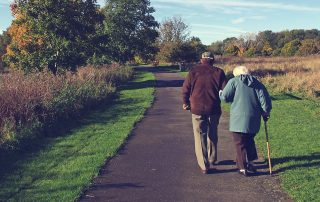 older retired couple walking