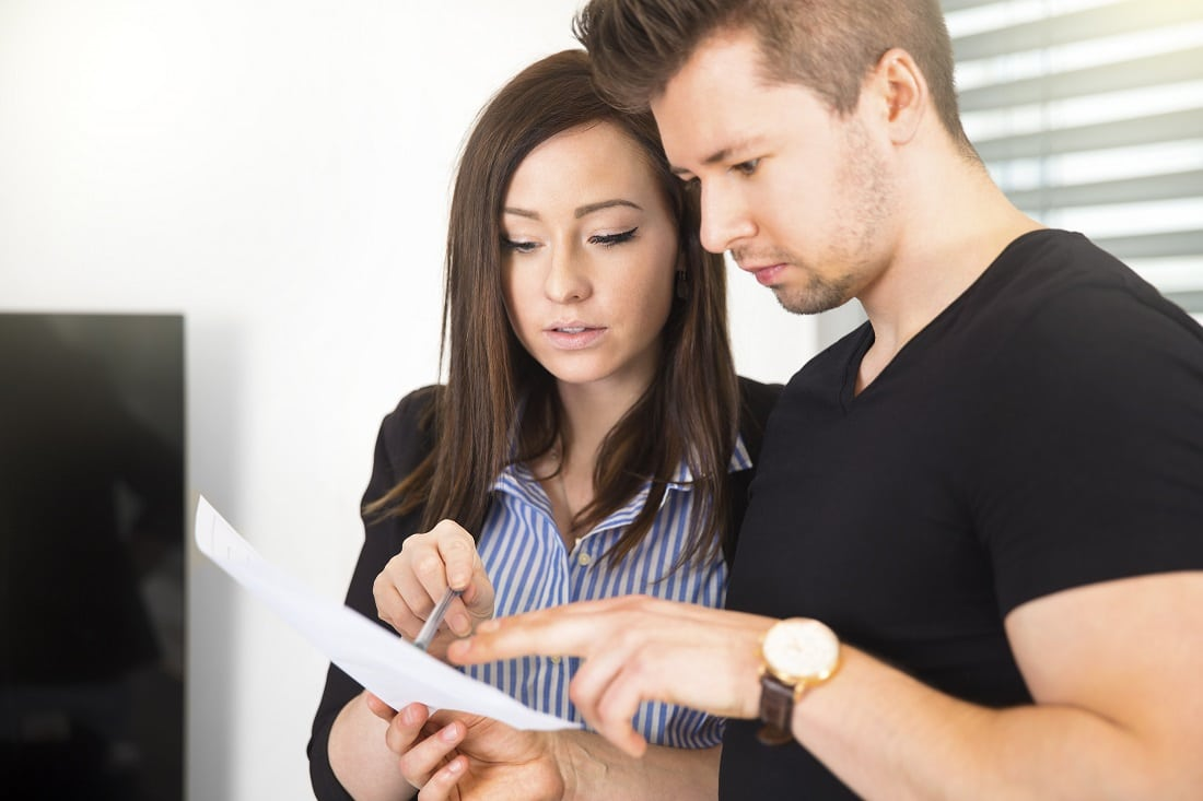 couple looking over a document