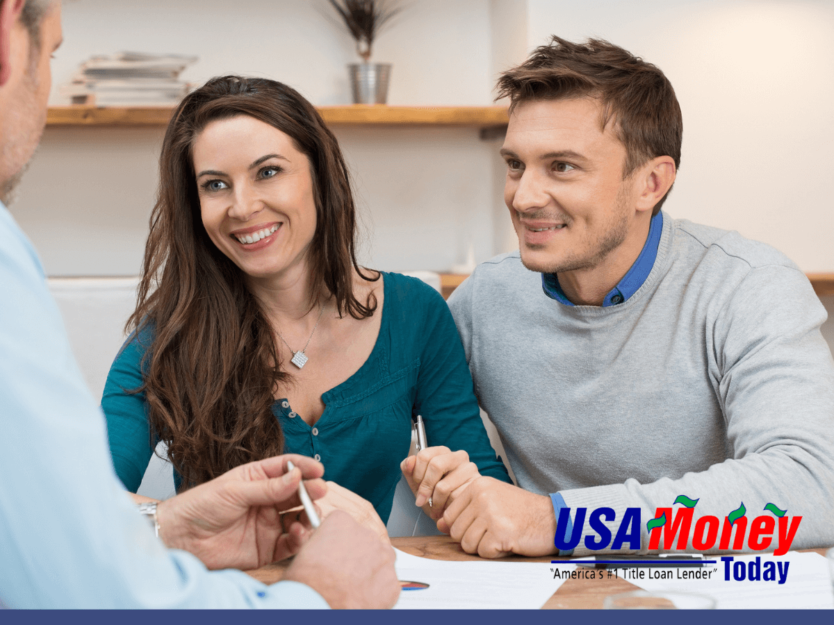 Couple talking with a title loan officer