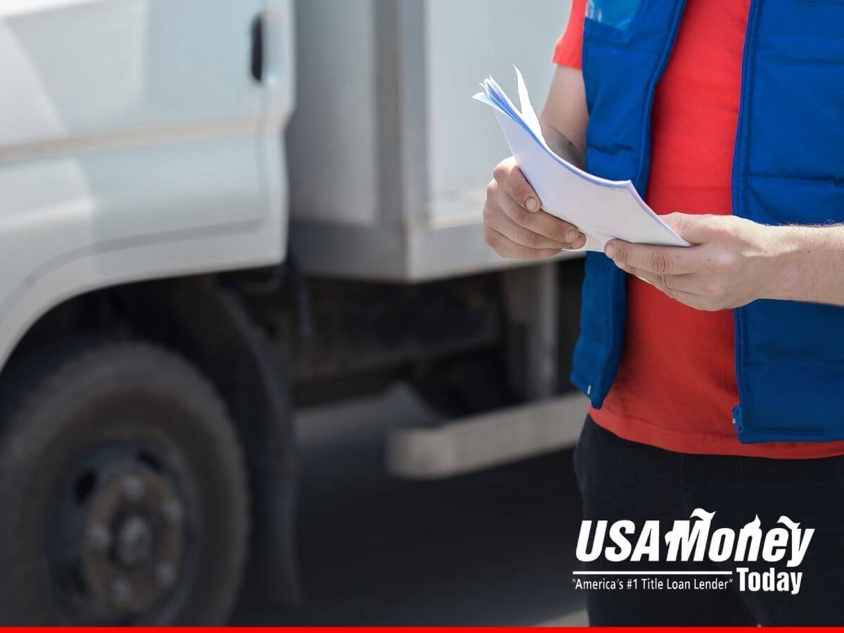 Man checking loan papers and thinking if a truck title loan can benefit his business